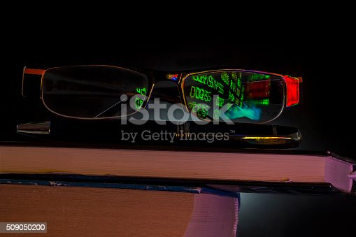 614338352istockphoto glasses with stock market reflection 509050200