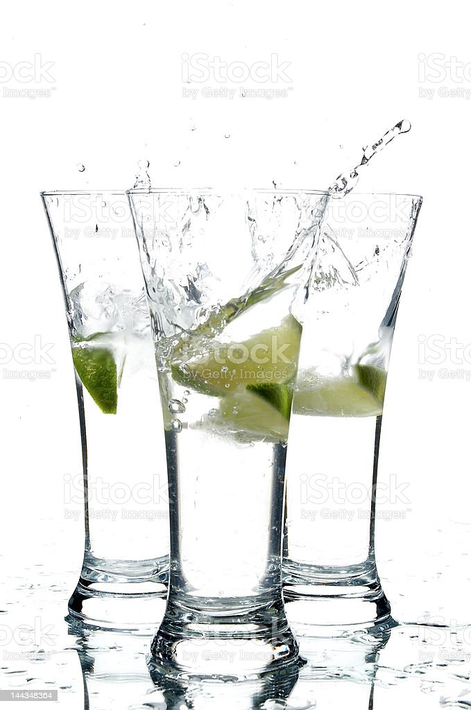 glasses with water and lime; royalty-free stock photo