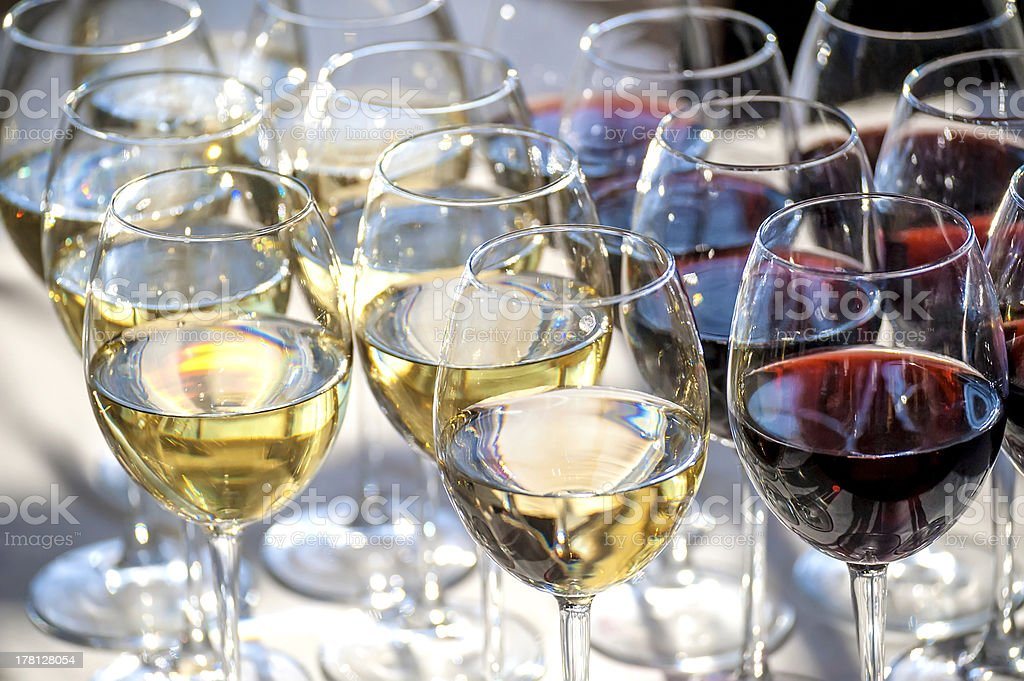 glasses with white and red wine close-up royalty-free stock photo