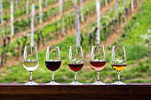 Glasses with wine. Red, pink, white wine in glasses. set of glasses with red, white and rose wine Tasting wine in the vineyard.