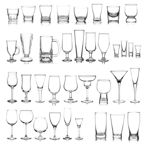 Glassware collection Large group of a variety of glasses isolated on white background. Composite image. martini glass stock pictures, royalty-free photos & images