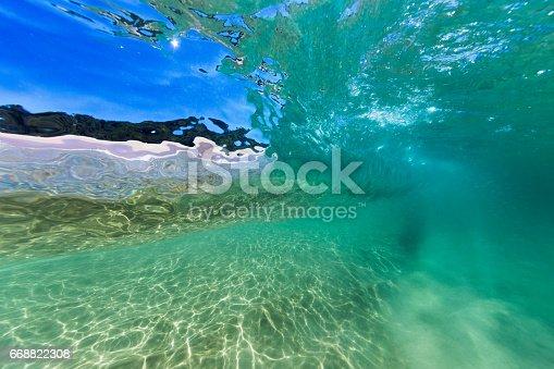 istock Glassy Underwater Wave Window 668822308