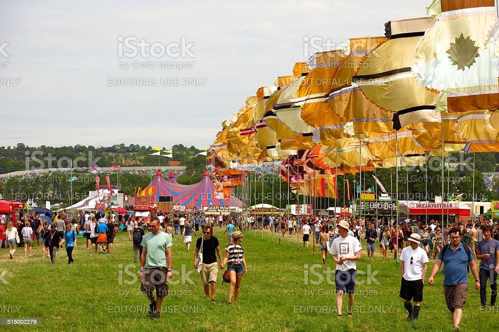 Glastonbury festival music festival sunny day crowds music tents stock photo