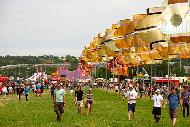 Glastonbury festival music festival sunny day crowds music tents stock photo