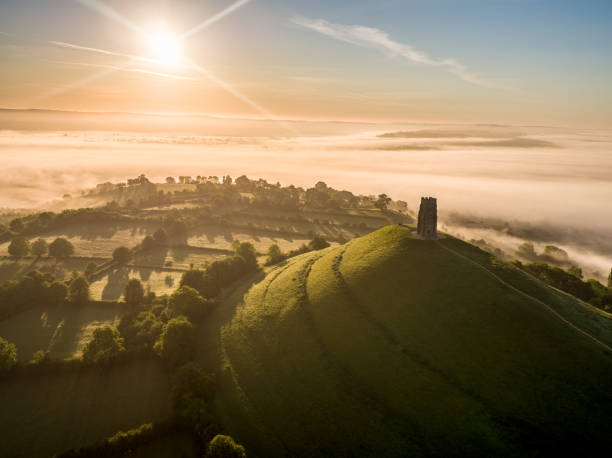 Glastonbury Tor Sunrise Glastonbury Tor Sunrise outcrop stock pictures, royalty-free photos & images