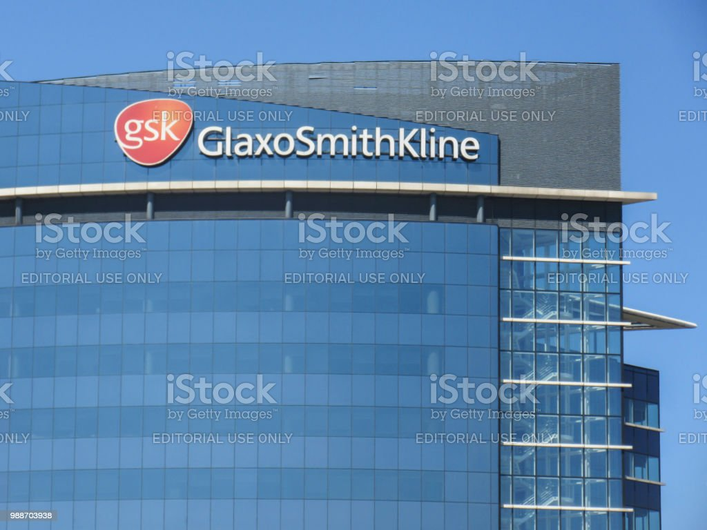 Glaxo Smith Kline headquarters, London Close up of signage and logo of the Glaxo Smith Kline hq in west London- a multinational pharmaceuticals company Brentford - London Stock Photo