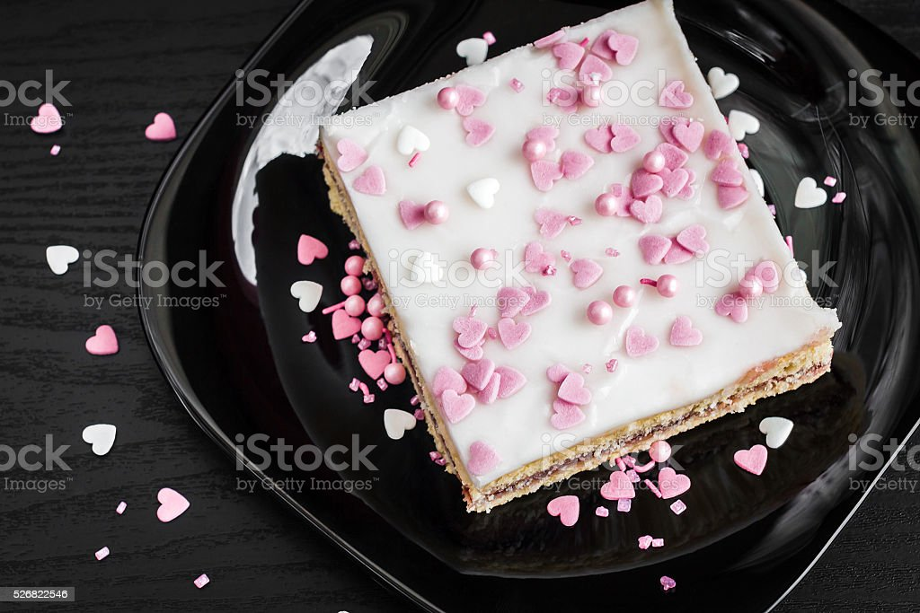 glazed  cake decorated with hearts stock photo