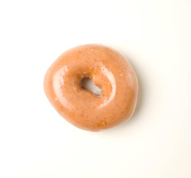 glaçage donut sur fond blanc - glaçage photos et images de collection