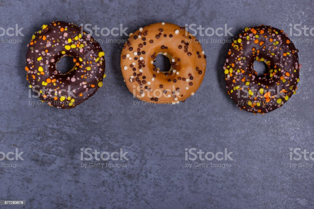 Glazed donuts with candy and chocolate stock photo