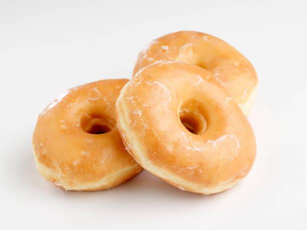 glaçage donuts - glaçage photos et images de collection