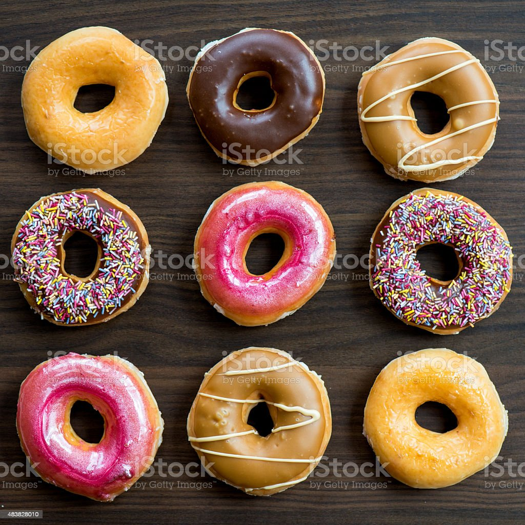 Glazed Doughnuts With Colourful Sprinkles And Icing Stock