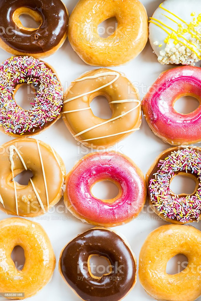 Glazed Doughnuts with colourful sprinkles stock photo