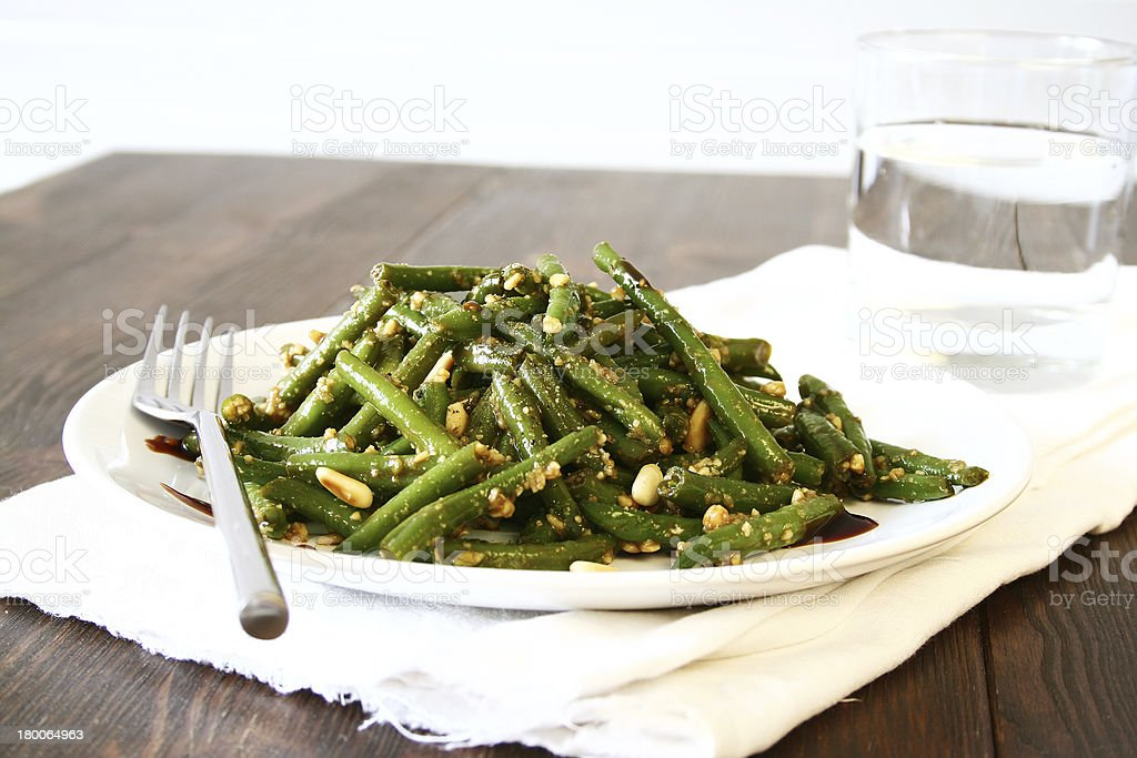Glazed Green Bean Salad with Pine Nuts royalty-free stock photo