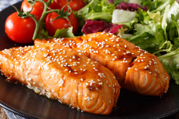 glazed salmon fillet with sesame close-up. horizontal - sesame stock photos and pictures