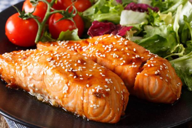 Glazed salmon fillet with sesame close-up. horizontal stock photo