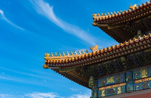 Glazed tile eaves of oriental traditional ancient buildings in the Forbidden City, Beijing, China