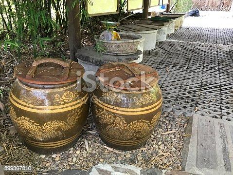 Glazed water jar with dragon pattern.