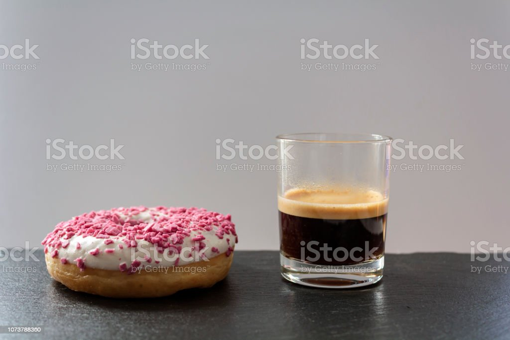 Glazes Donut and a cup of black coffee