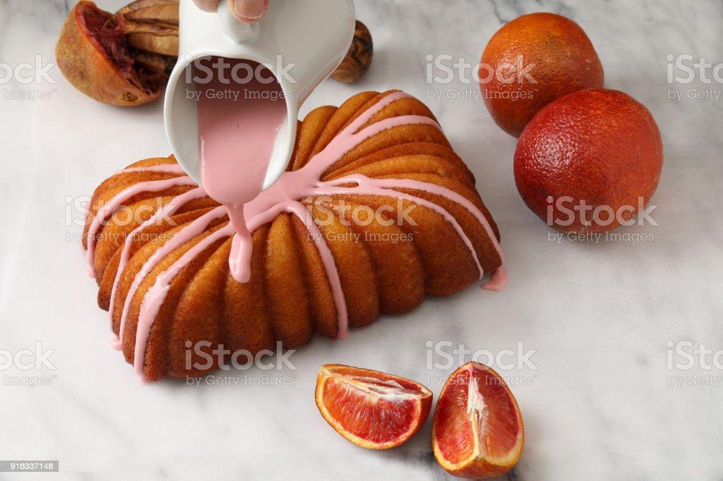Glazing A Blood Orange & Yogurt Cake Loaf stock photo