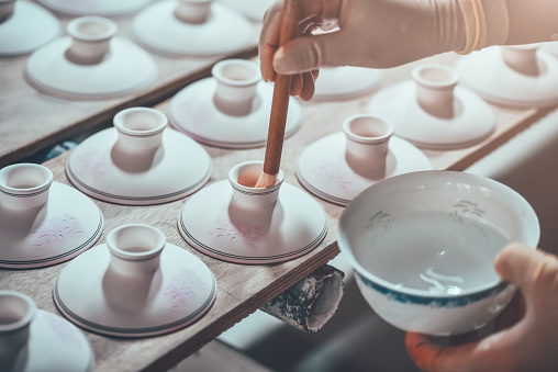 Glazing A Porcelain Cup in A Factory