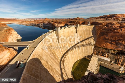 Glen Canyon Dam is a concrete arch dam on the Colorado River in northern Arizona in the United States, near the town of Page. The dam was built to provide hydroelectricity and flow regulation from the upper Colorado River Basin to the lower. Its reservoir is called Lake Powell, and is the second-largest artificial lake in the country.