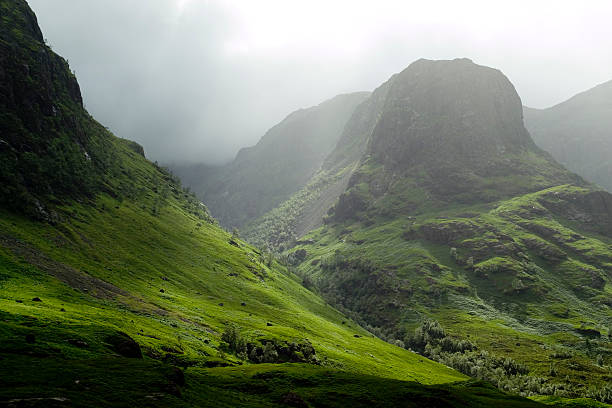 Glencoe pass on a misty day The Glencoe pass on a misty day site of the historic massacre. scottish highlands stock pictures, royalty-free photos & images