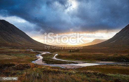 Glencoe view of the vally during a sunrise, with a river in the foreground