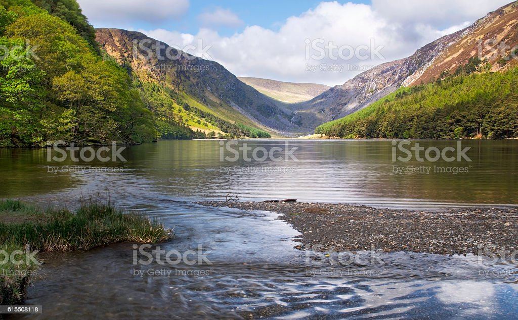 Glendalough upper lake lit up by the sun, ireland stock photo