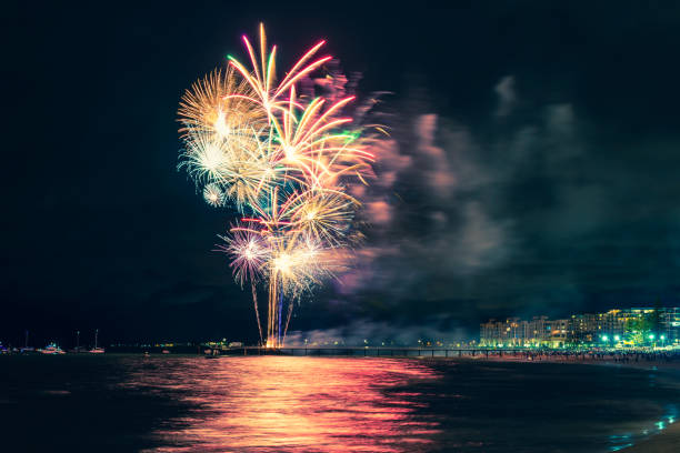 Glenelg beach New Year fireworks Fireworks display on New Year eve at Glenelg beach from jetty, South Australia pyrotechnic effects stock pictures, royalty-free photos & images