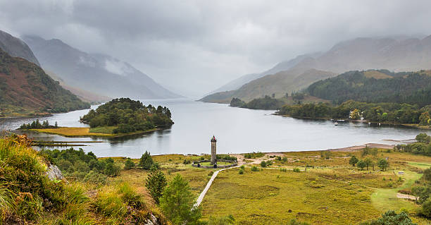 Glenfinnan momument and Loch Shiel panorama Glenfinnan, Highlands, Scotland - September 23, 2014: dramatic landscape panorama of Bonnie Prince Charlie monument at Loch Shiel near Fort William. Stuart pretender begun the Jacobite uprising here. culloden stock pictures, royalty-free photos & images
