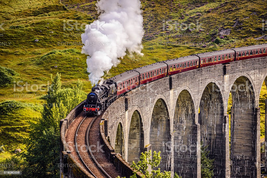 Glenfinnan Railway Viaduct in Scotland with a steam train stock photo