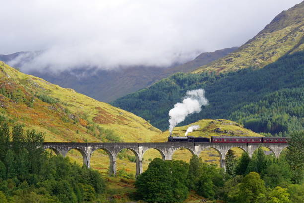 Glenfinnan Viaduct and The Jacobite Steam Train Glenfinnan Viaduct, The Jacobite steam train, Hogwarts Express, Scotitsh Highlands scottish highlands stock pictures, royalty-free photos & images