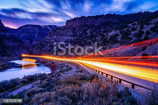 Glenwood Canyon Interstate 70 Colorado at Night - Time exposure of automobiles moving through going eastbound and westbound.