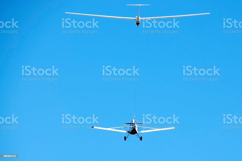 Glider and Tow PLane in Flight with Blue Sky royalty-free stock photo