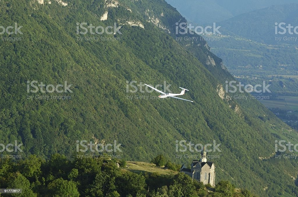 glider flying over St Michel Church royalty-free stock photo