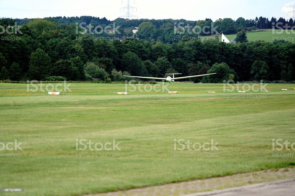 glider landing at the airport stock photo