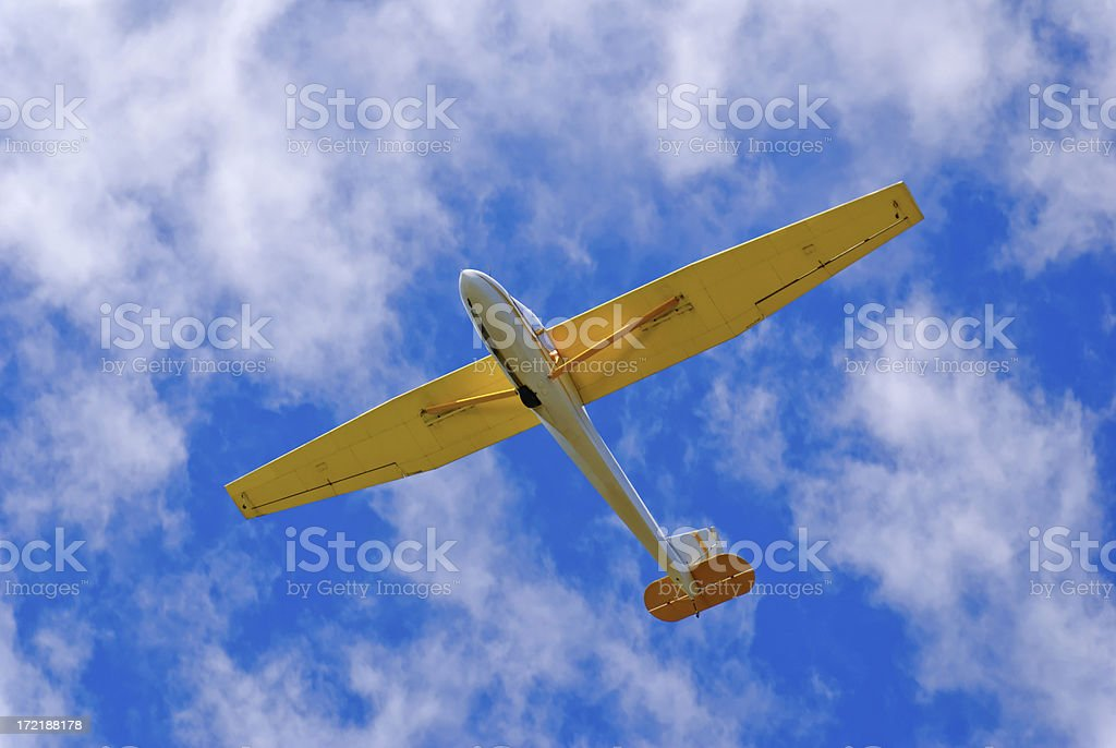 Glider or Soar Plane Against a Perfect Blue Cloudy Sky royalty-free stock photo