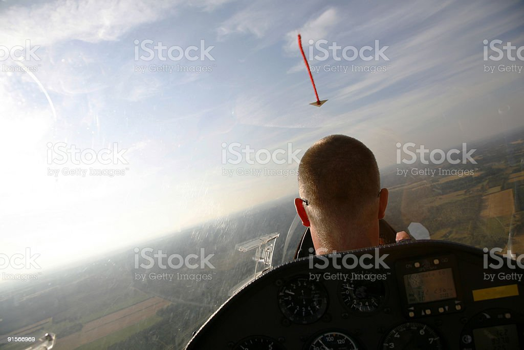 Glider pilot in low light royalty-free stock photo