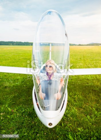Woman preparing to fly in glider.