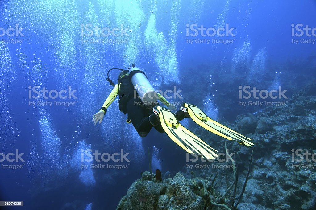 Gliding over the edge of a wall royalty-free stock photo
