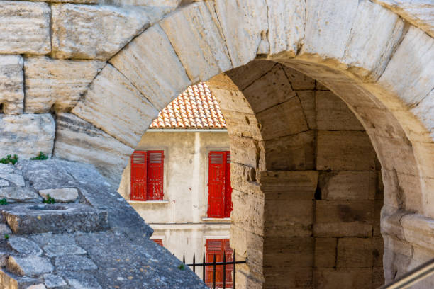 Glimpse between past and present in Arles (Provence-Alps-French Riviera, France). stock photo