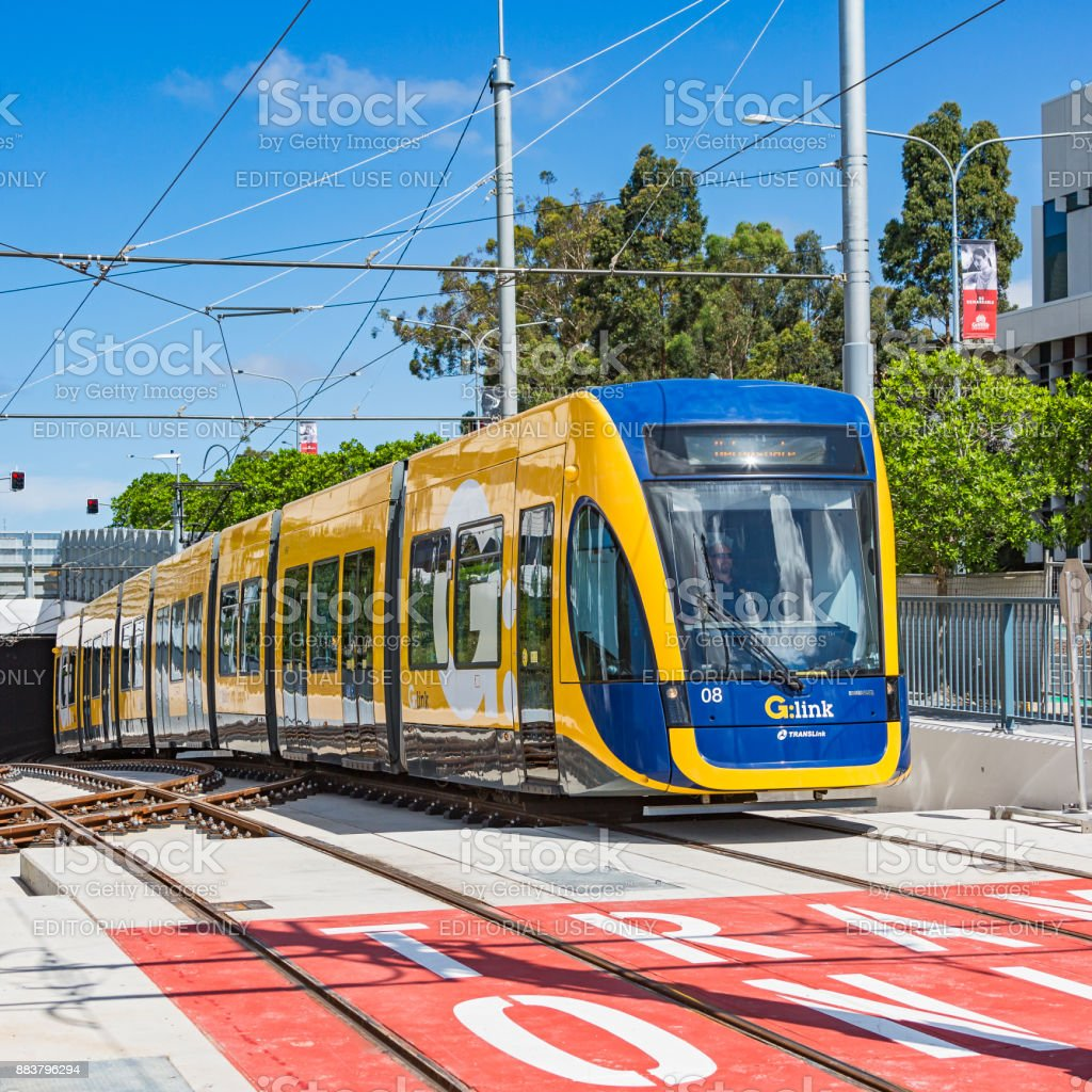 G:link light rail emerging from Gold Coast University Hospital tunnel onto new tracks stock photo