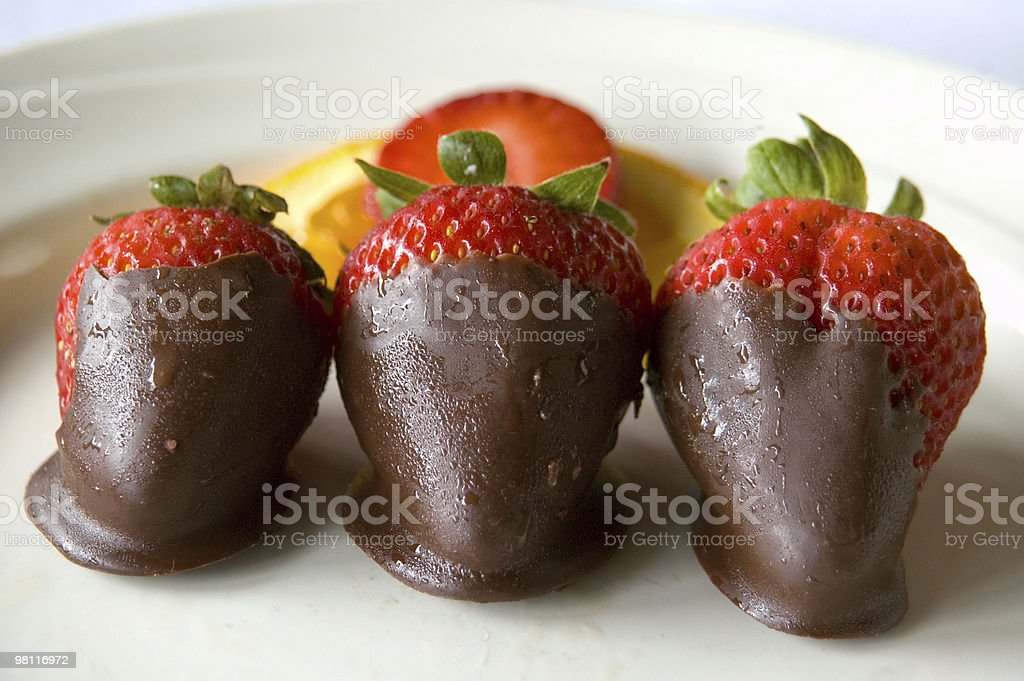 Glistening strawberries dipped in chocolate royalty-free stock photo