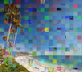 Glitch effect due to photo processing on an image with palms and ocean