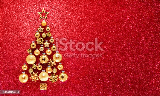 istock Glitter And Baubles In Christmas Tree 619388724