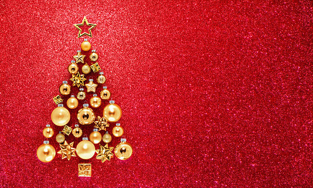 glitter and baubles in christmas tree - christmas stock photos and pictures