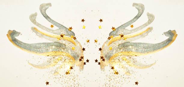 glitter und glitzernden sternen auf abstrakte gold und schwarz aquarell flügel in vintage-farben. - nägel glitzer stock-fotos und bilder