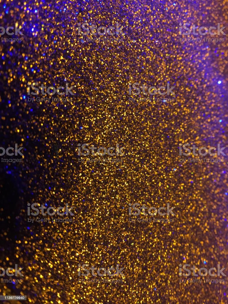 Christmas abstract background-gold purple glitter sparkling