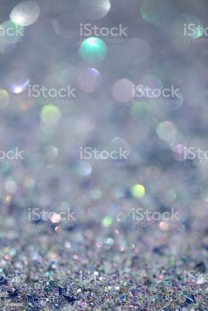Glitter Background XXXL photo - macro of silver iridescent glitter with very short depth of field to create a blurred sparkle background, with crisp focus texture towards bottom.   Abstract Stock Photo