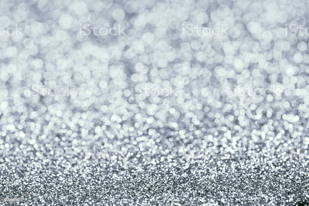Glitter Background. Silver Texture. Glow Light Effect. Royalty Free Stock  Photo